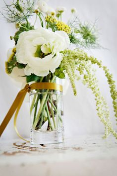 Gorgeous green arrangement with cascading floral. Love the variety, looks wild and handpicked. Perfect natural colours.