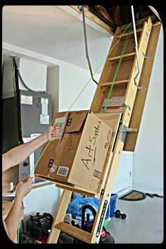 Easy hack for moving objects up a ladder into the attic