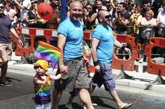 MUST READ ARTICLE: WHY GAY PARENTS MAYBE THE BEST PARENTS...Gay parents march with their child in a Pride parade.