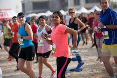 Competitors take part in the DXB Beach Run at Umm Suqeim Park Beach on January 16, 2016 in Dubai, United Arab Emirates.