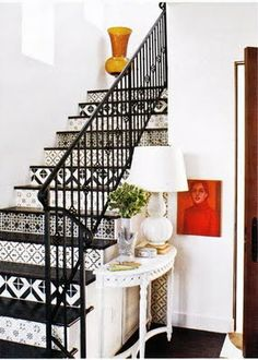 Monocramatic patterned stairs paired with cast iron railing.