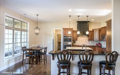 This #kitchen and breakfast nook offer lots of seating around a central island. The Foxglove #1297. http://www.dongardner.com/house-plan/1297/the-foxglove. #HomePlan #DreamHome