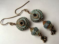 """""""Deep down"""" I made the earrings with some of my polymer clay beads (covered with swellegant), czech glass beads and tiny metall elements. Their tribal and ancient look resonates with me perfectly :)"""