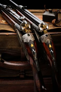 Things of art! A pair of Over/Under heavy hunting, magnum caliber rifles.: