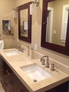 Recessed medicine cabinets and rectangular undermount sinks. Want single handle faucets though (not double handles).