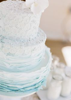 Featured Photographer: Cara Leonard Photography, Featured Cake: Megan Joy Cakes; Lovely light blue ombre wedding cake with different textures