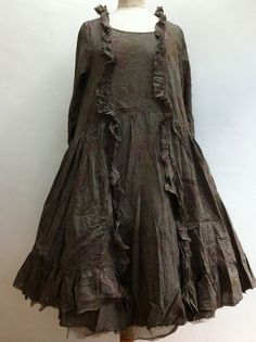 (SESAME-CLOTHING...) Such lovely rumpled clothing....in what appears to be gunmetal or dark pewter. A very interesting piece, hidden and fascinating.  Love this!!