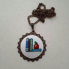 Cross stitch pendant, kanaviçe kolye, #handmadebyme Tiny Cross Stitch, Cross Stitch Books, Cross Stitch Alphabet, Wool Embroidery, Cross Stitch Embroidery, Cross Stitch Patterns, Book Necklace, Cross Stitch Collection, Brazilian Embroidery