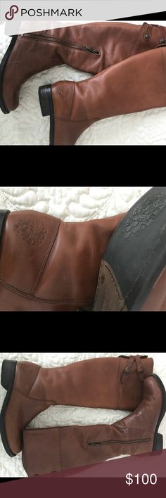 Vince Camuto boots Lt brown y'all riding boot by Vince Camuto. Good condition,1 button missing from tab at the top of the boot. Not very noticeable. Vince Camuto logo @ the base of the boot and the soles. Size 7.1/2 no box , no scuff marks Vince Camuto Other