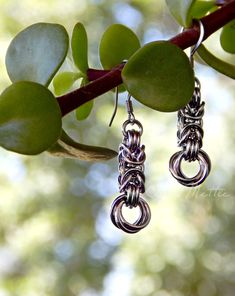 "These stainless steel earrings are handmade from rings using a Byzantine weave, with Love Knots anchoring them on the ends. They are 1.6"" from the top of the earwire to the bottom.  They are made to compliment our most popular item, a stainless steel Byzantine bracelet.  Make a complete set with the matching necklace with a Love Knot drop. All Stainless Steel, Stainless Steel Earrings, Boot Bling, Chainmaille Bracelet, Matching Necklaces, Byzantine, Copper Jewelry, Gifts For Wife, Knots"