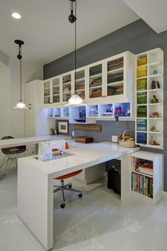 Craft Rooms to Inspire You - Closet Factory An all white design provides a blank slate in this custom sewing station, allowing your colorful supplies to pop behind glass Craft Room Design Ideas (Creative Rooms) Spacious Sewing Room in Contem Sewing Room Design, Craft Room Design, My Sewing Room, Sewing Spaces, Sewing Office Room, Ikea Sewing Rooms, Small Sewing Rooms, Sewing Closet, Sewing Desk