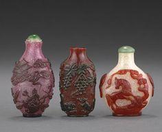 Three overlay decorated glass snuff bottles