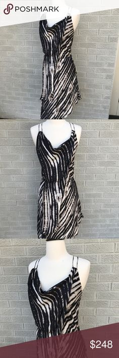 "Haute Hippie Draped Asymmetrical Print Silk Dress Haute Hippie Draped Asymmetrical Print Silk Dress! Love this black & tan print! This style is so flattering & beautiful! 100% Silk. Size XS. Midi length. 34"" long at the shortest & 48"" long at the longest. 13"" across the stretchy Waist. Like new!! BS1168081017 Haute Hippie Dresses Asymmetrical"