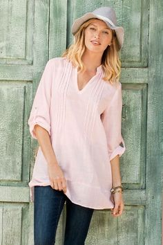 With feminine pintuck details and a soft cotton blend, the Adela Shirt is sure to be a new wardrobe favorite. Available in four pastel colors.