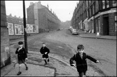 .UK. 1960. Three boys running in streets. (c) Bruce Davidson