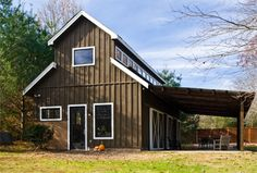 simple barn-converted house. love the awning and windows.