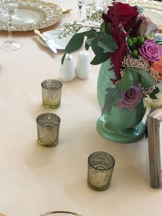 Stunning flowers arranged in a vintage green shell vase.  Perfect for a Victorian Seaside Splendor wedding at Castle Hill Inn