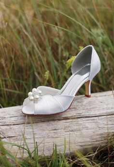 The Shellie dyeable peep toe mid heel with scalloped edge is a super cute option for brides and 'maids! #davidsbridal #weddingshoes