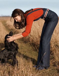 Catherine, Duchess of Cambridge and Lupo, the family dog making their debut in British Vogue. The Duchess of Cambridge, photographed by by Josh Olins in the Norfolk countryside, the Duchess appears in a 10-page shoot within the June 2016 issue, the first magazine shoot that she has ever consented to.Dungarees: AG JeansSweater: Claudia Schiffer for TSEBoots: DuneBelt: stylist's own