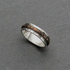 This Handcrafted Copper and Sterling Silver Ring is textured & patinated. Available in whole and half sizes, sizes 5-10.