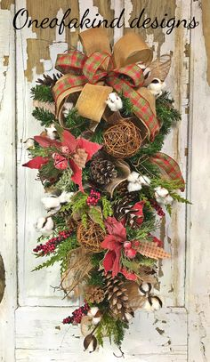 Rustic deco mesh Christmas swag with cotton, grapevine balls, and pine cones