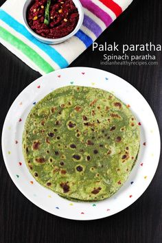 Palak paratha or spinach paratha is a Indian flatbread made with spinach, wheat flour & spices. It's eaten with a chutney Lunch Snacks, Lunch Box Recipes, Snack Box, Gujarati Recipes, Indian Food Recipes, Gujarati Food, Biryani, Chapati Recipes, Puri Recipes