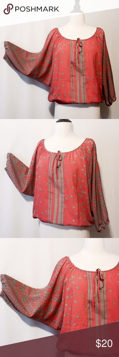 ✨ Coral & Tan Printed Butterfly Top Lovable!!! Coral background with khaki hearts and stripe printed blouse. Featuring scoop neckline with Ty closure, elastic waist at hem, three quarter butterfly sleeves with elastic. 100% Poly Machine Washable Express Tops Blouses