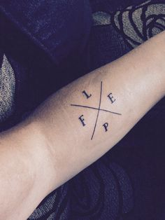 Forearm Tattoo - F for family and friends, L for love, E for equality and P for pride