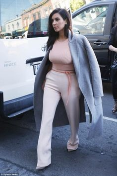 Kim Kardashian wearing Celine Fall 2014 Rtw Collection Coat, Giuseppe Zanotti Suede Pointed Toe Pumps and Jonathan Simkhai Cropped Ribbed-Knit Top