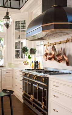 Black Enamel and Brass Stove and Hood, Kitchen by ADParchitects.com.