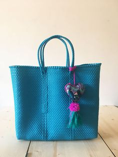 MULTICOLOR MEXICAN BAG BRIGHT BLUE **Please choose with or without pompom (variations) This is a hand woven Tote, waterproof and hand washable, made from recycled plastic. Hands from Oaxaca Size: 33x34x12cm / 13X13X4in (aprox) 100% Handmade CIOLULA, DISEÑO MEXICANO SHIPPING INFO: Standard