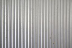 How to Install Corrugated Metal Walls Invented in the corrugated metal can make any house have a rustic, vintage look. Install it easily with some patient and the right tools. You'll give your house some old-fashioned personality in no time. Aluminium Texture, Aluminum Metal, Metal Siding, Metal Roof, Galvanized Tin Walls, Galvanized Shower, Sheet Metal Wall, Centerpieces, Facades