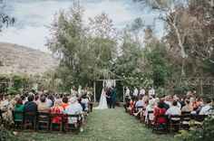 laid-back and easy outdoor ceremony - with a macrame ceremony backdrop