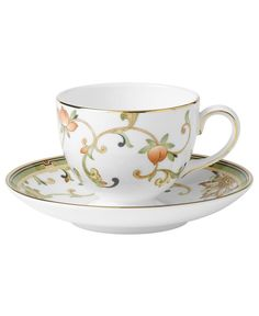 In 18th century England, Josiah Wedgwood, creator of the world famous Wedgwood ceramic ware, established a tradition of outstanding craftsmanship and artistry which continues today. The exotic floral design of the Oberon dinnerware and dishes pattern is finely scaled and exquisitely precise, in soft shades of green and gold accented with black, against pure white bone china. | Bone china | Dishwasher safe | Web ID:24410