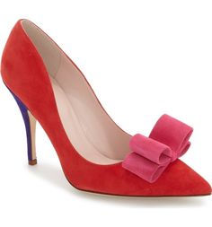 Swooning over these color-blocked pumps by Kate Spade. A pink bow underscores the playful style.