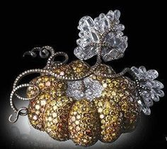 Pumpkin colored diamond brooch  Michelle Ong for Carnet