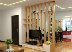 This simple and awesome divider is useful as well as beautiful. The room is separated with long vertical wooden columns and the provision of shelves and media cabinet is an added advantage. Office Room Dividers, Fabric Room Dividers, Portable Room Dividers, Wooden Room Dividers, Bamboo Room Divider, Hanging Room Dividers, Folding Room Dividers, Living Room Partition Design, Living Room Divider