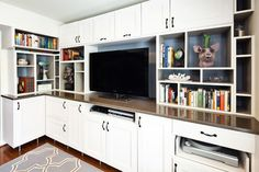 Einstein Entertainment Center contemporary-living-room using ikea kitchen cabinets.  Check out the turn table pull out!
