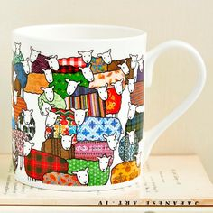 Fine Bone China Mug with illustration of colourful sheep by Mary Kilvert.    Height: 8cm. Diameter: 7cm.    Dishwasher safe.    Shipped in protective