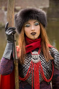 The Silk Road Warrior.  Scale mail Vietnamese Ao Dai made of tsumugi silk. Leather gloves Fur hat Glaive ...and lots of beads.  Design by Eva Helena