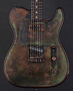 James Trussart Guitars Titanic Green Gator SteelTopCaster. Satin Brown Relic Mahogany Body. 52 Koa Neck with a Rosewood Fingerboard. Arcane Inc. Tele Bridge and TV Jones Neck Pickups.