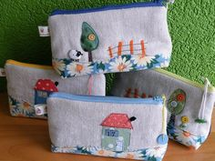 love these!  linen and scrap fabric makeup bags