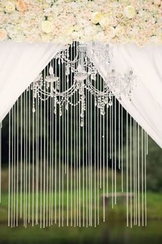 Wedding Archway with dangling beads and chandelier.