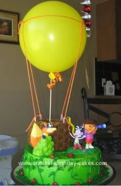 Homemade Dora the Explorer Birthday Cake: This was a Dora the Explorer Birthday Cake I made for my daughter's 1st birthday.  I used 2 8 layer cakes for the base and 4  round cake for the balloon