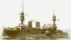 """French battleship Jaureguiberry, commissioned in 1897. French designers favored what came to be known as """"fierce face."""" Most of their battleships combined high freeboard with exaggerated tumblehome (meaning that the ships were much wider at the waterline than at the main deck, with sides that sloped inward and allowed for turrets or barbettes mounted on the broadsides which could fire fore, aft, or to the side)."""