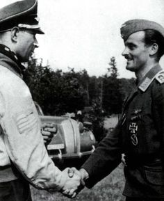 Werner Mölders congratulates Oberfeldwebel Edmund Wagner upon his winning the Iron Cross, First Class.
