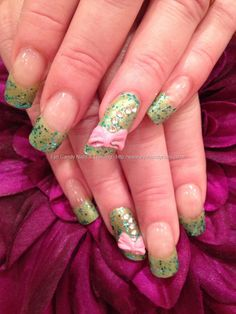 Green glitter polish with lipstick shaped ring fingers with 3D acrylic bow nail art