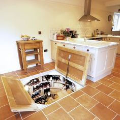 Wine cellar trap door, hell I could even store my nintendo 3ds in there.