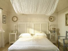 Headboards help to create a bedroom's ethos and using some vintage shutters as the main idea behind this space's style is not only gorgeous but flavorful. It's romantic, unique and great inspiration to use in your own home