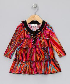This tunic celebrates every color in the crayon box with its vibrant print. Stretchy fabric and tiers of ruffles and button details mean little girls won't ever have to sacrifice their fun for fashion. 95% polyester / 5% spandexHand wash; hang dryImported